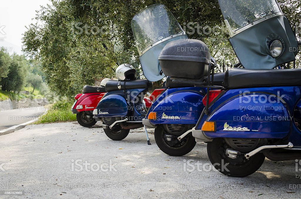 Four colored italian scooters (Vespa) parked in Monte Isola, Ita stock photo
