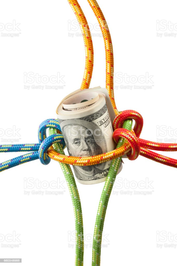 Four colored ropes with roll of dollar banknotes stock photo