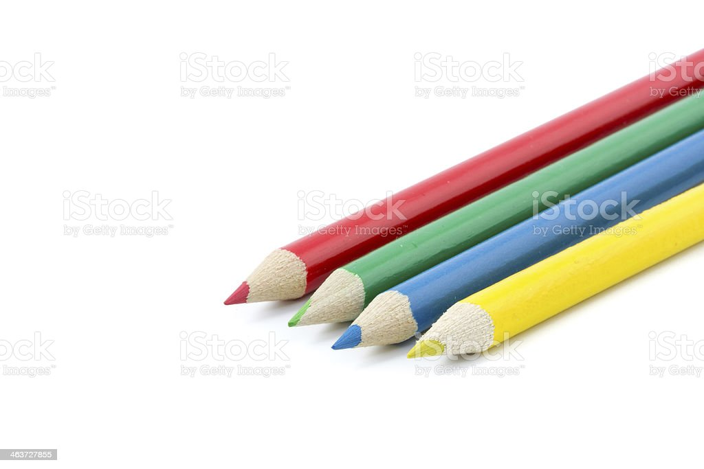 four colorful pencils on a row stock photo