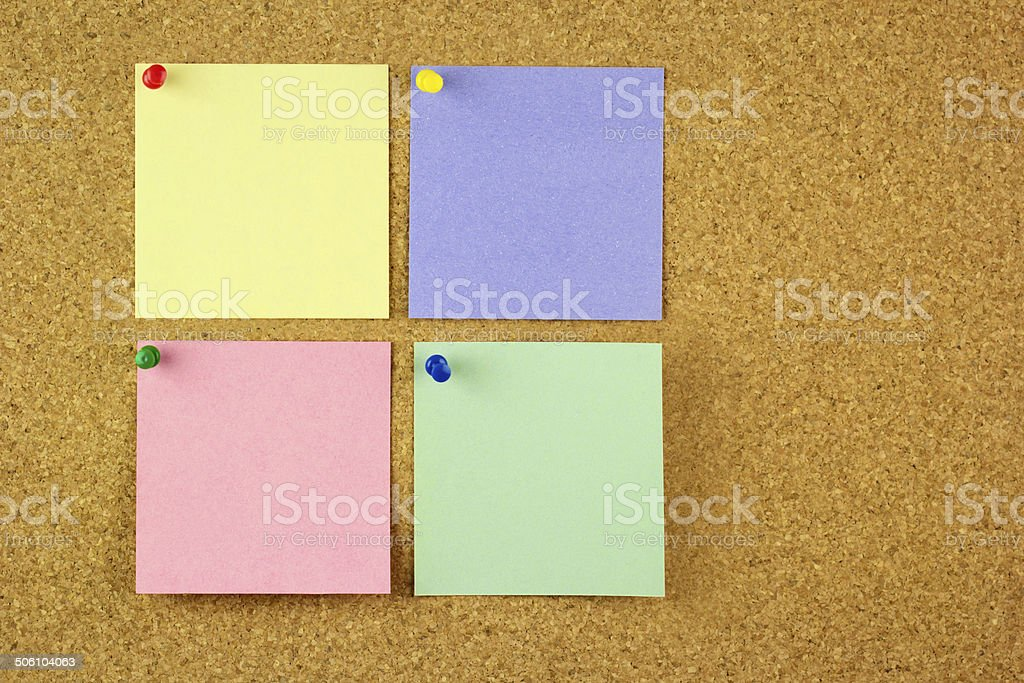 Four colorful stickers on the cork stock photo