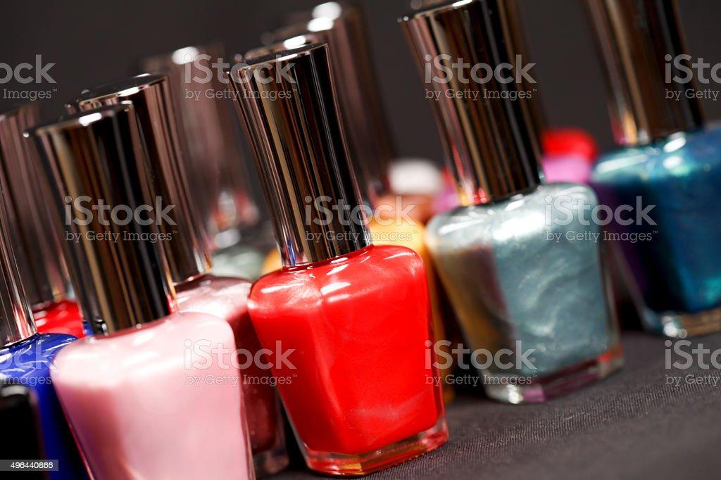 Four colour nail varnish bottles stock photo