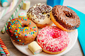 Four colours of donuts