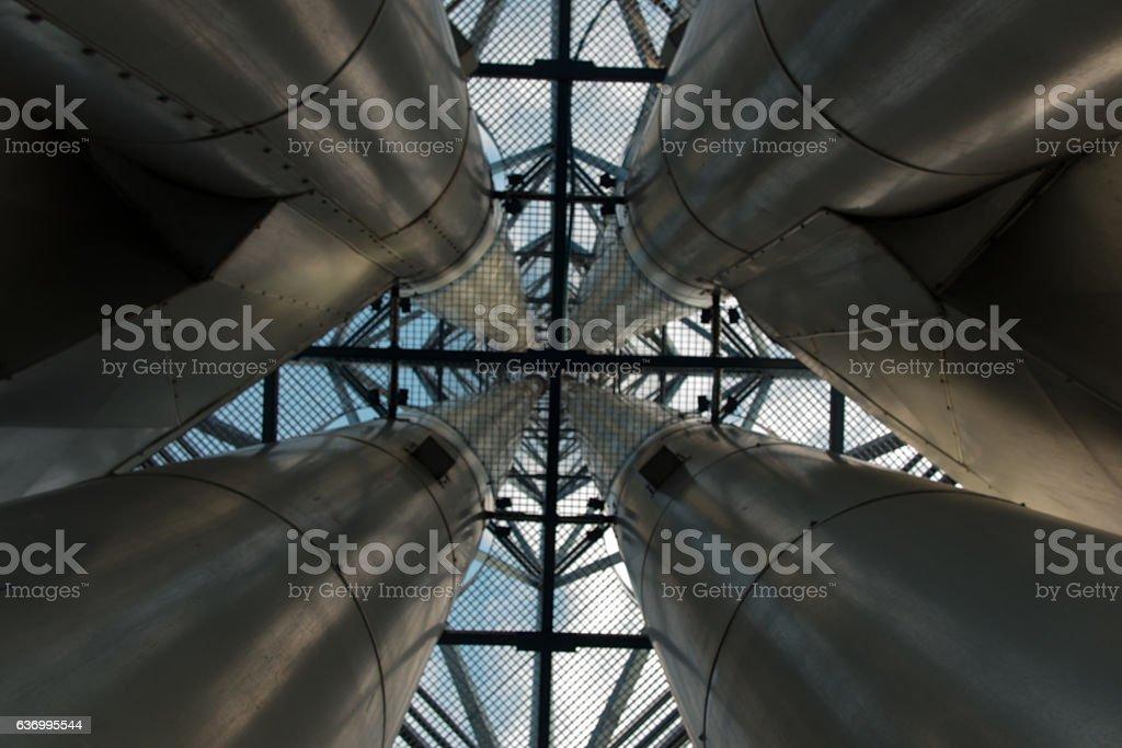 four complex metal chimneys stock photo