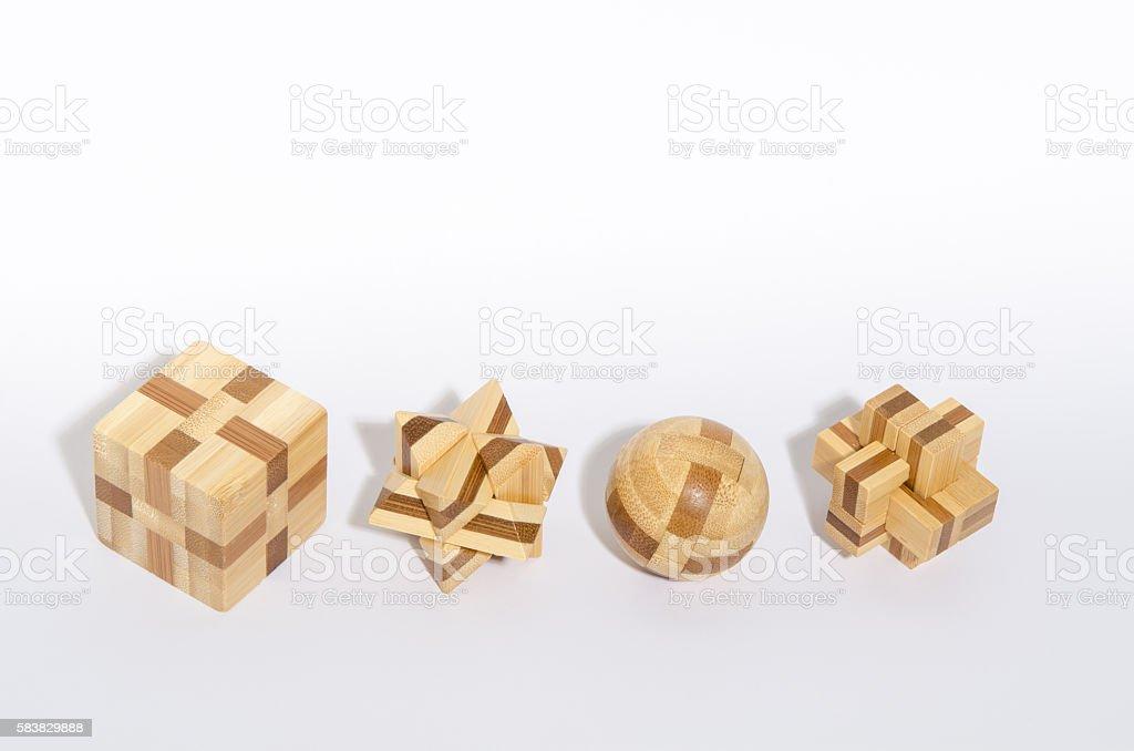 Four Complex Wooden Puzzle stock photo