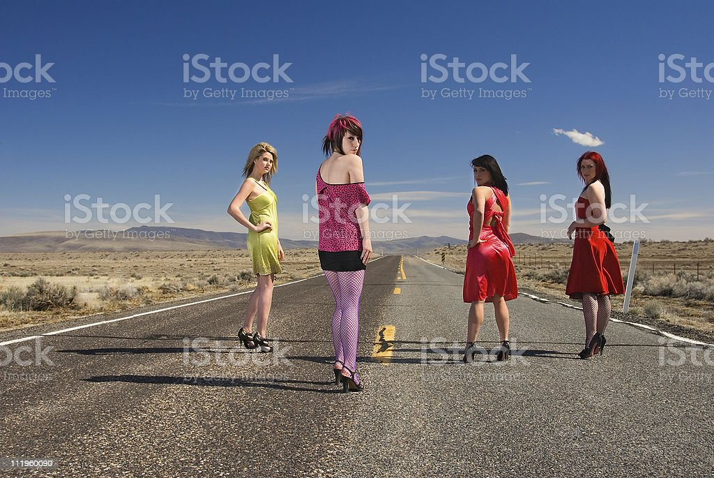 Four confident young women standing in the middle of road royalty-free stock photo