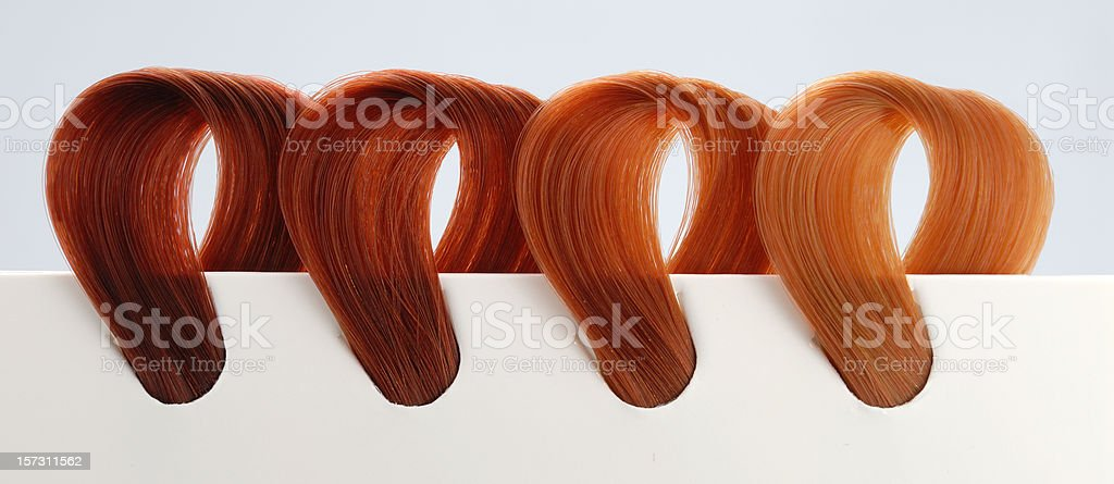 four copper tone hair swatches stock photo