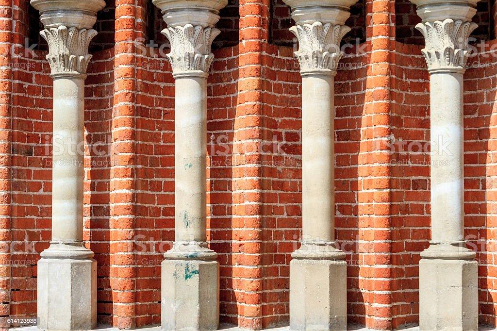 Four Corinthian columns on a brick wall of a church stock photo