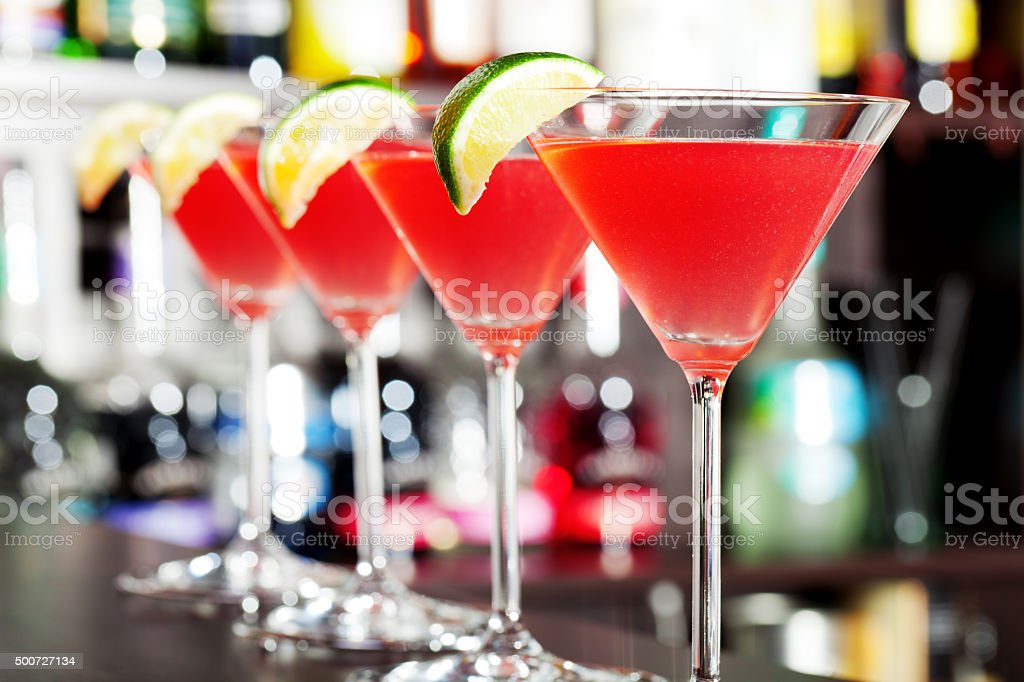 Four Cosmopolitan cocktails stock photo