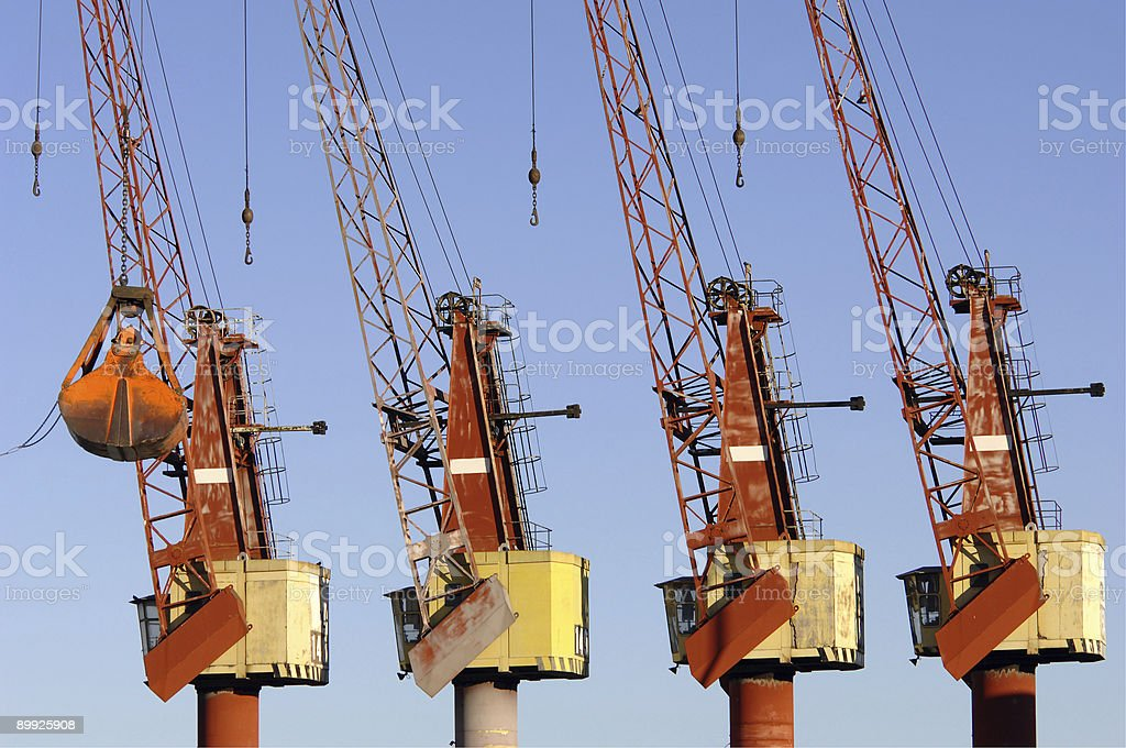 Four cranes in the port royalty-free stock photo