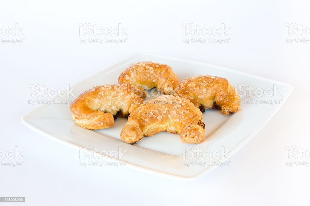 Four crosissants on white plate royalty-free stock photo