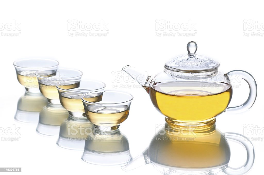 Four cups of tea and a teapot. royalty-free stock photo