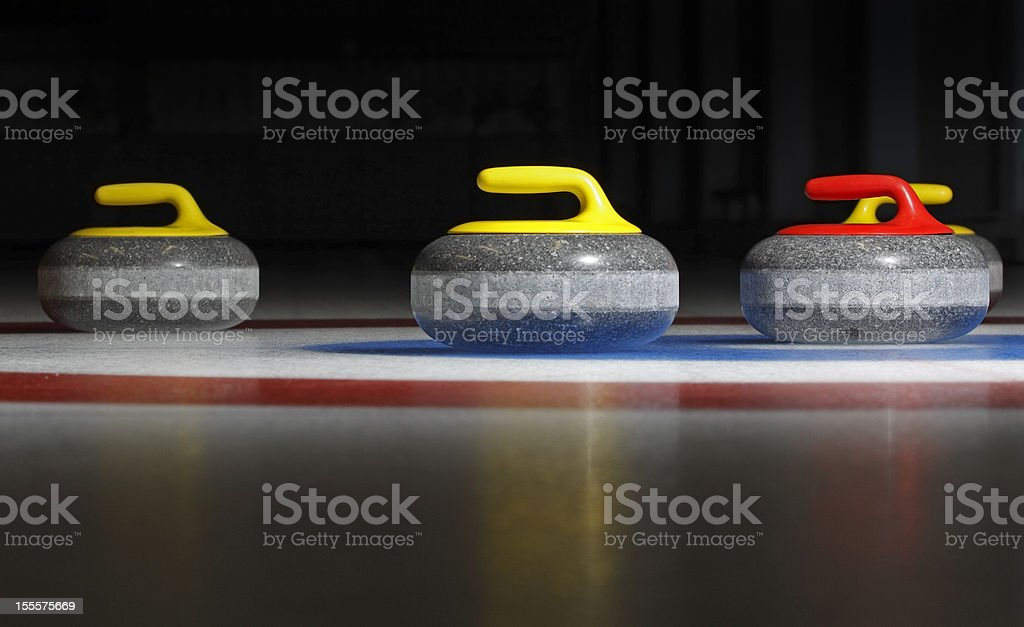 four curling stones stock photo