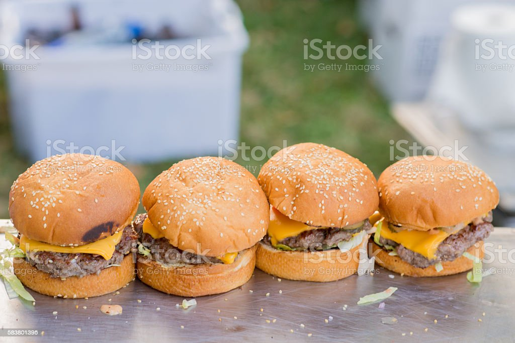 Four delicious hamburgers, Closeup of home made burgers stock photo