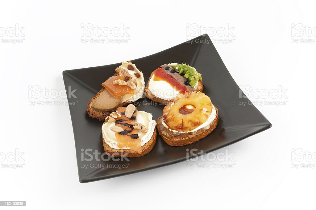 Four delicious toasted cheese with different ingredients royalty-free stock photo