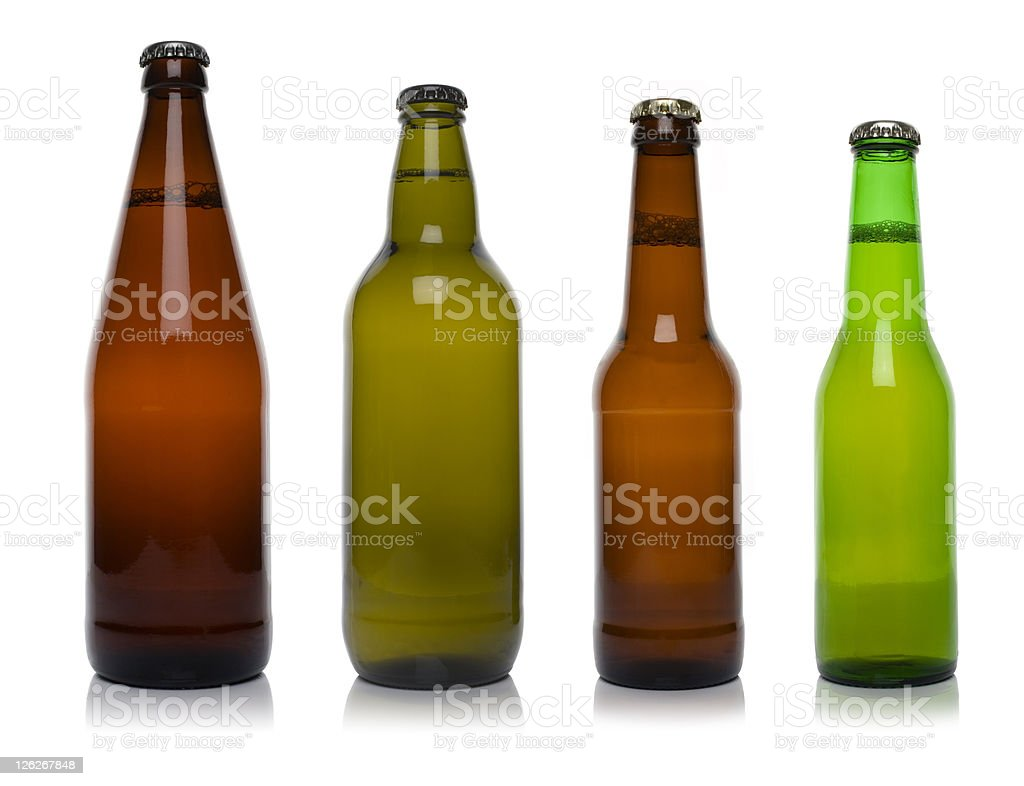Four different beer bottles isolated on white stock photo