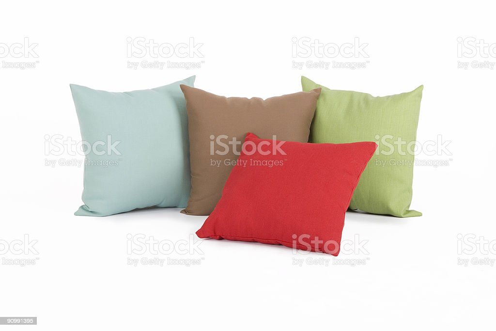 Four different colored pillows stock photo