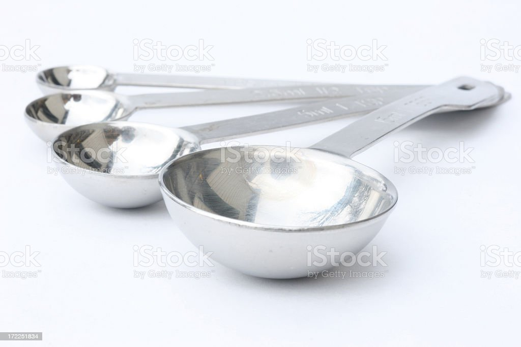 Four different sizes measuring spoons stock photo