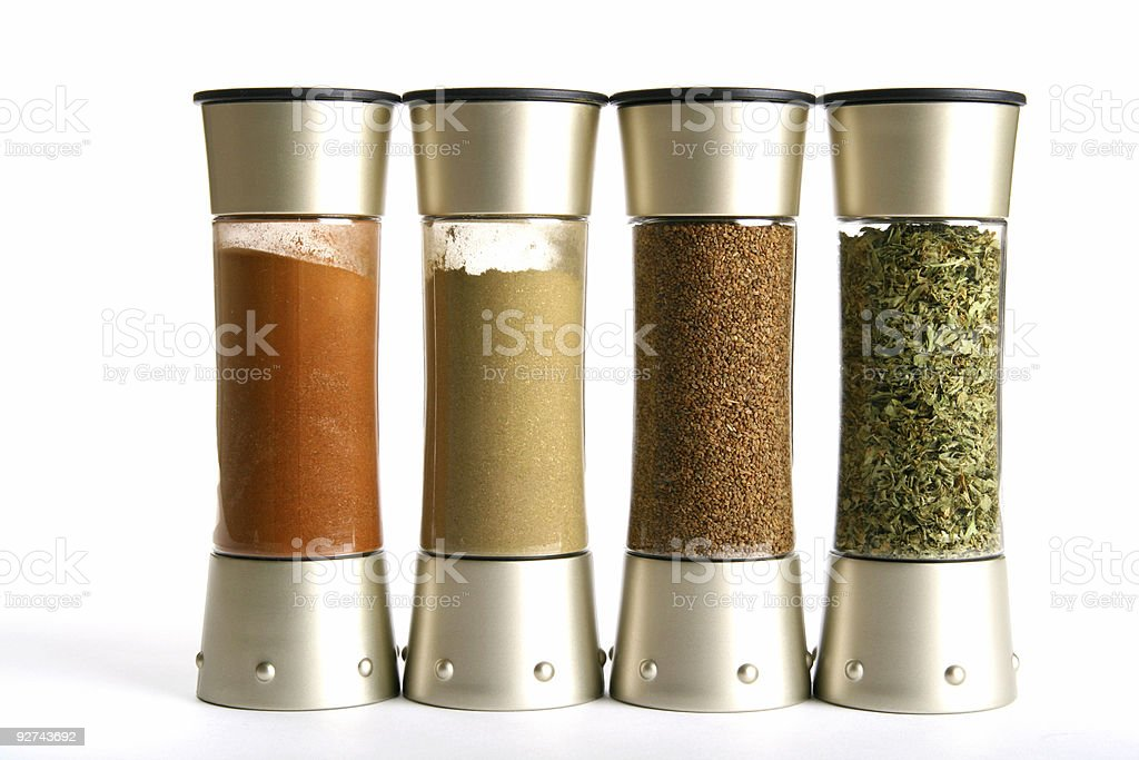 Four different types and colors of spices in jars  stock photo