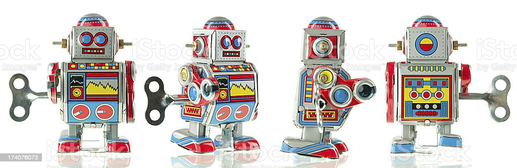 Four different views of vintage tin robot isolated on white stock photo