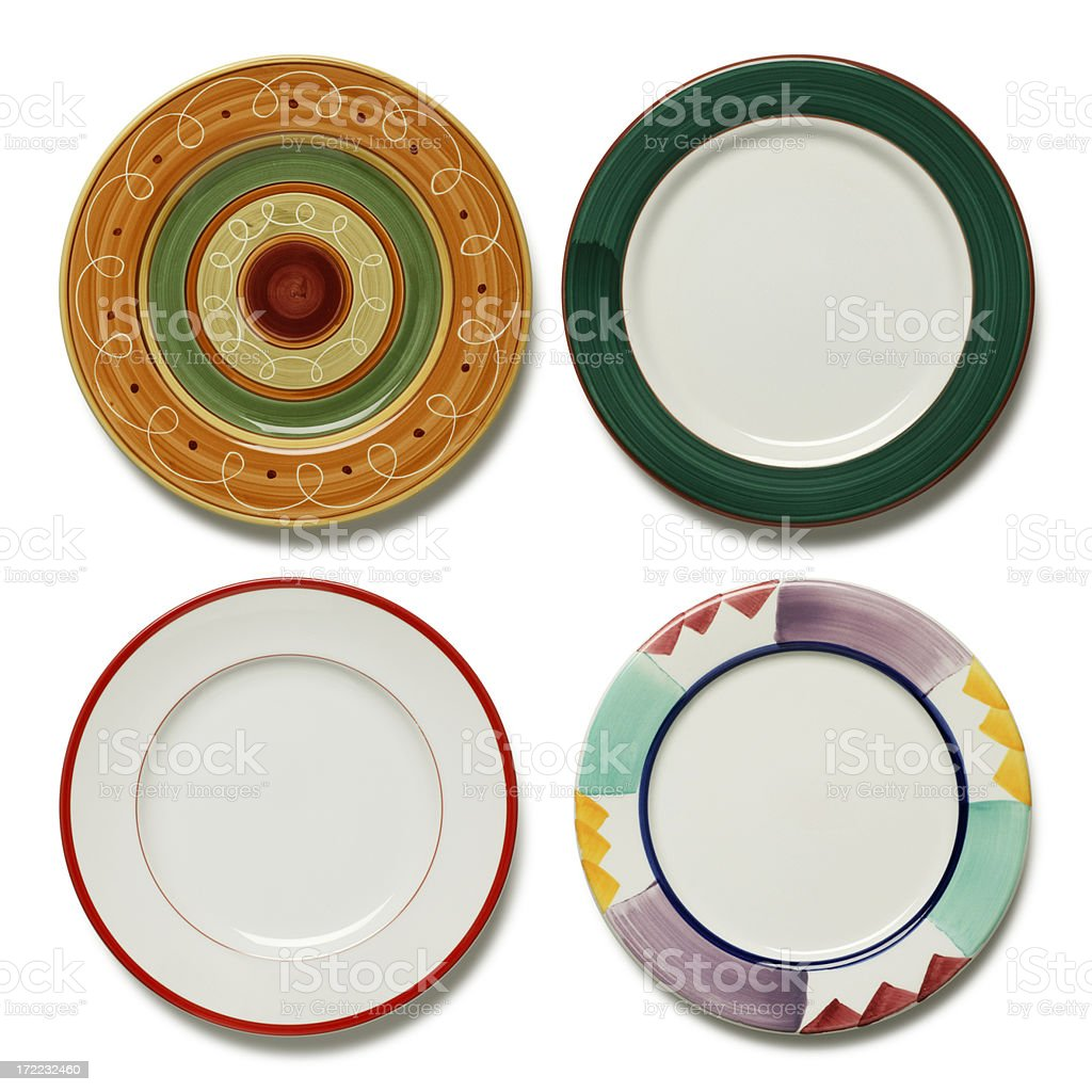 Four dinner plates on white background royalty-free stock photo