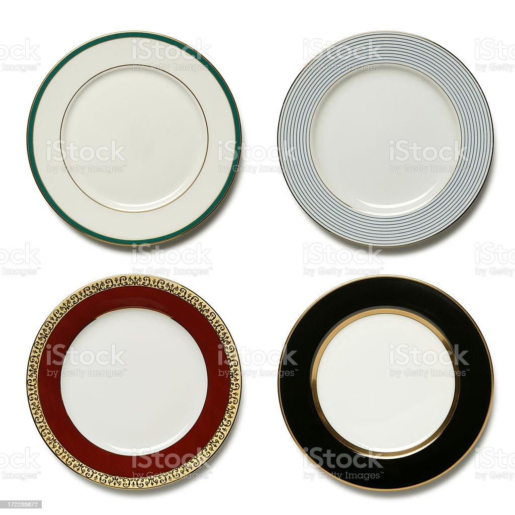 Four dinner plates on white background royalty-free stock photo