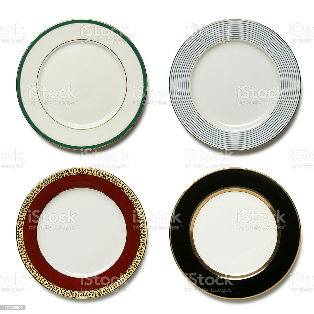 Four dinner plates on white background stock photo