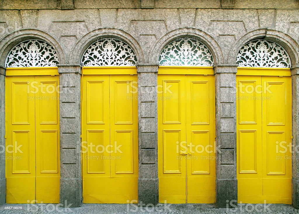 Four doors of a colonial building stock photo