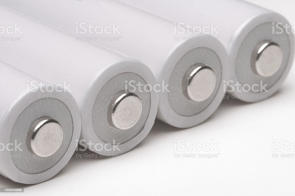 Four double a batteries on white background. royalty-free stock photo