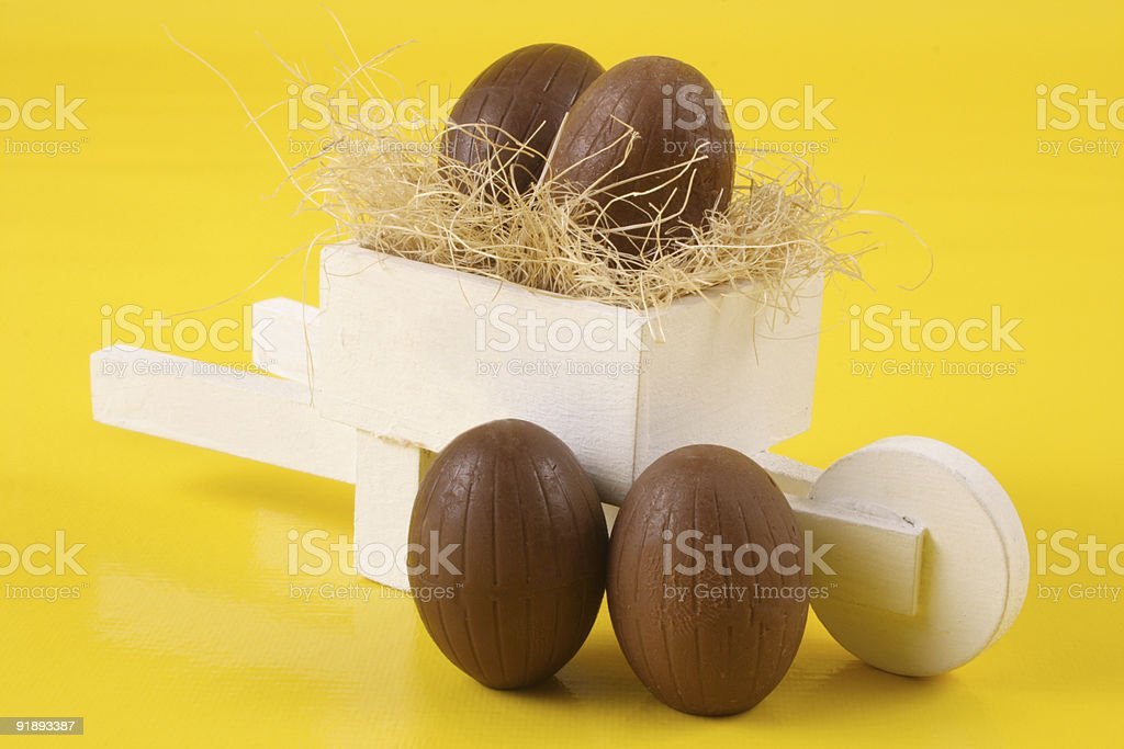 Four Easter eggs and pushcart royalty-free stock photo
