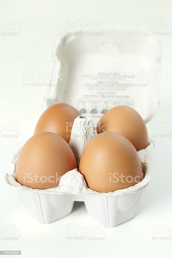 Four eggs container royalty-free stock photo