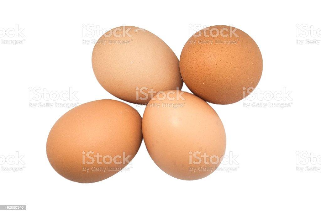 four eggs in white background stock photo
