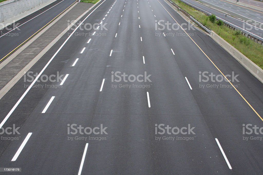 Four empty road lanes on highway 401 freeway interstate royalty-free stock photo