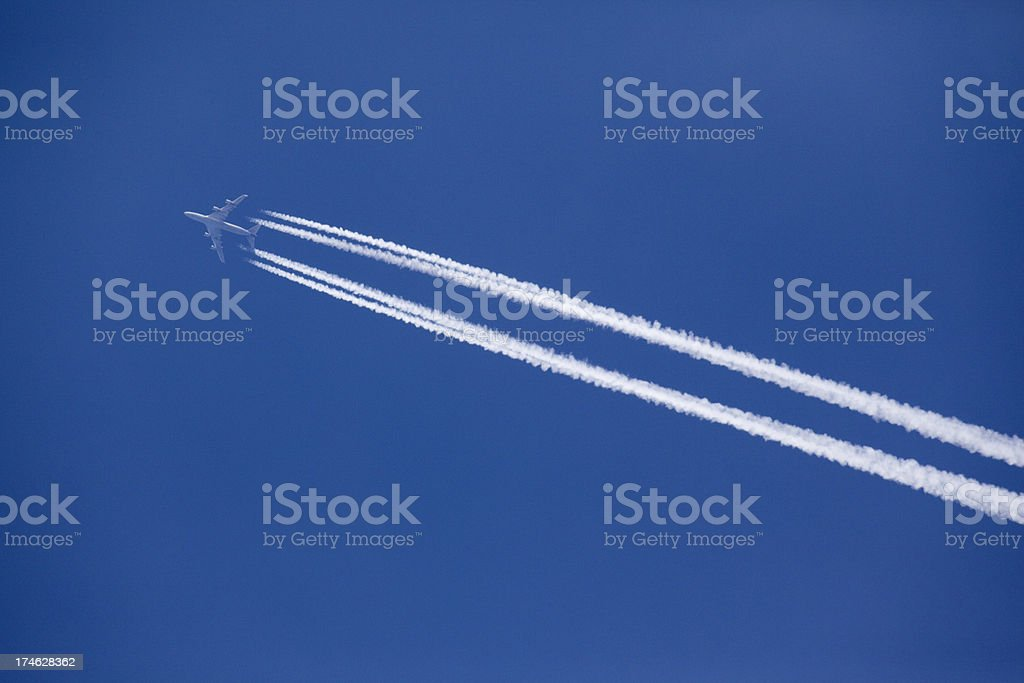 Four engine contrail royalty-free stock photo