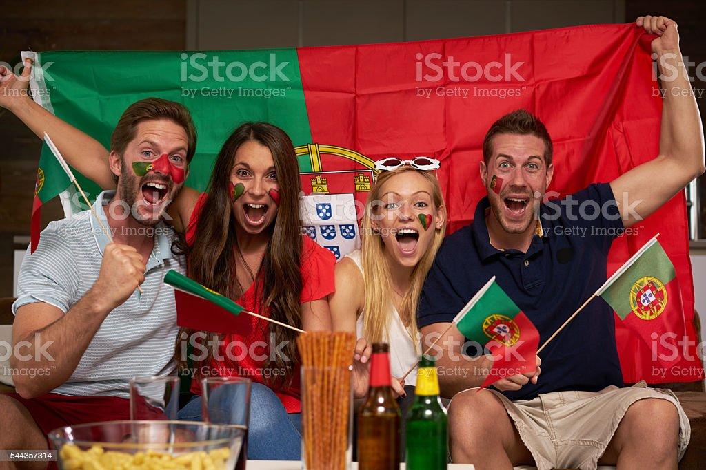 four enthusiastic Portuguese soccer fans stock photo