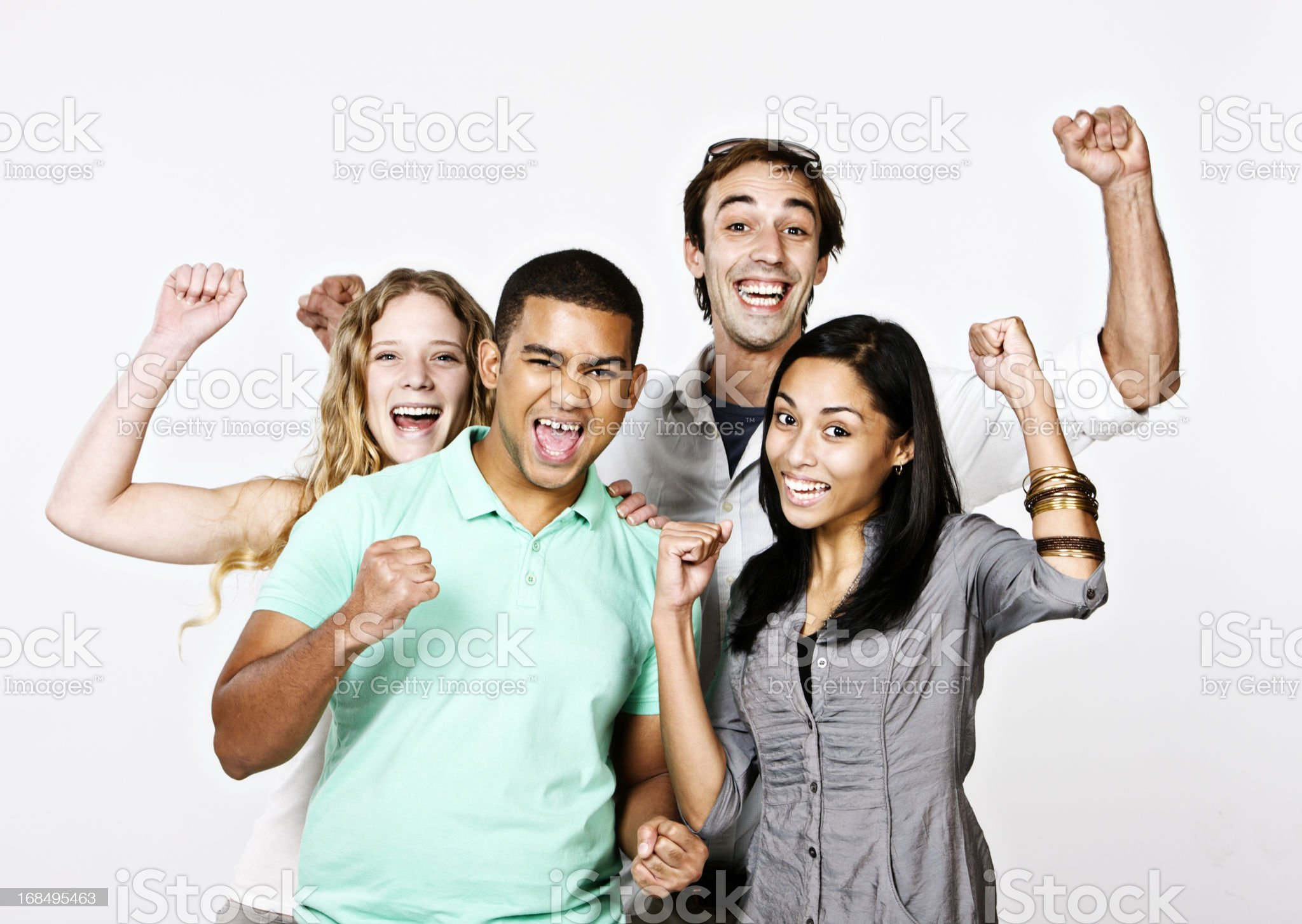 Four excited energetic fans wave and shout supporting their side royalty-free stock photo