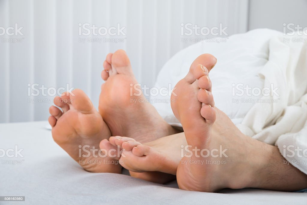 Four Feet In Bed stock photo