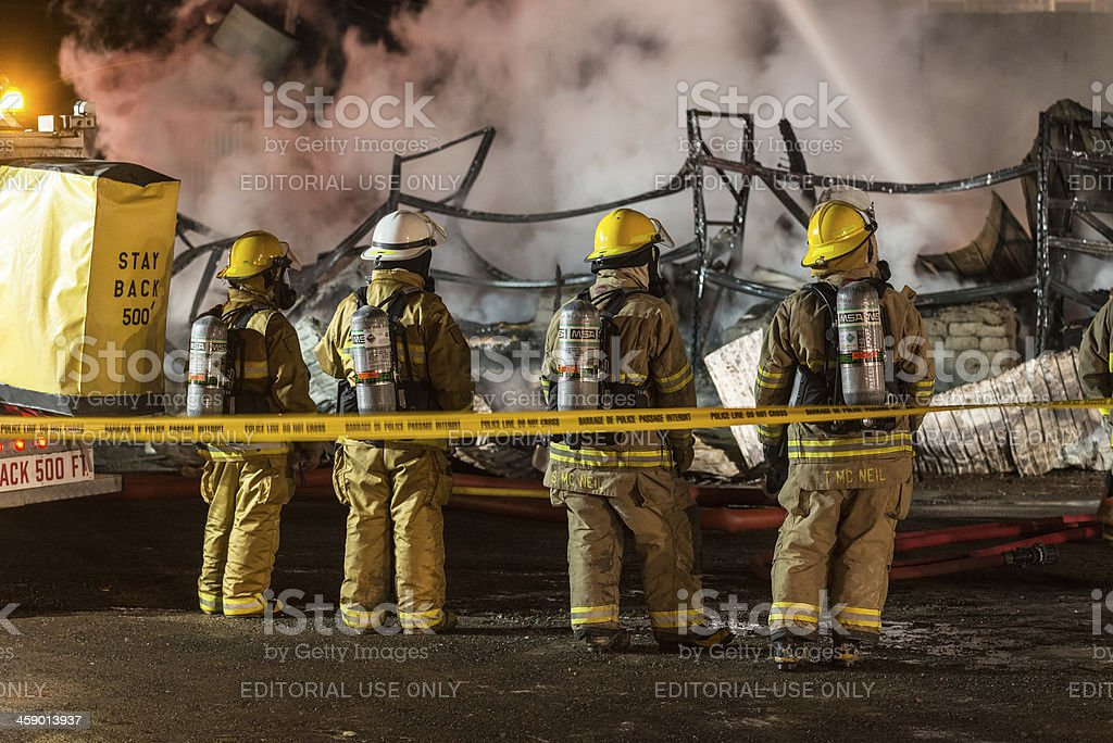 Four Firefighters stock photo