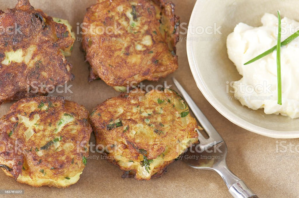 Four Fish Fritters on Parchment Paper from Above stock photo