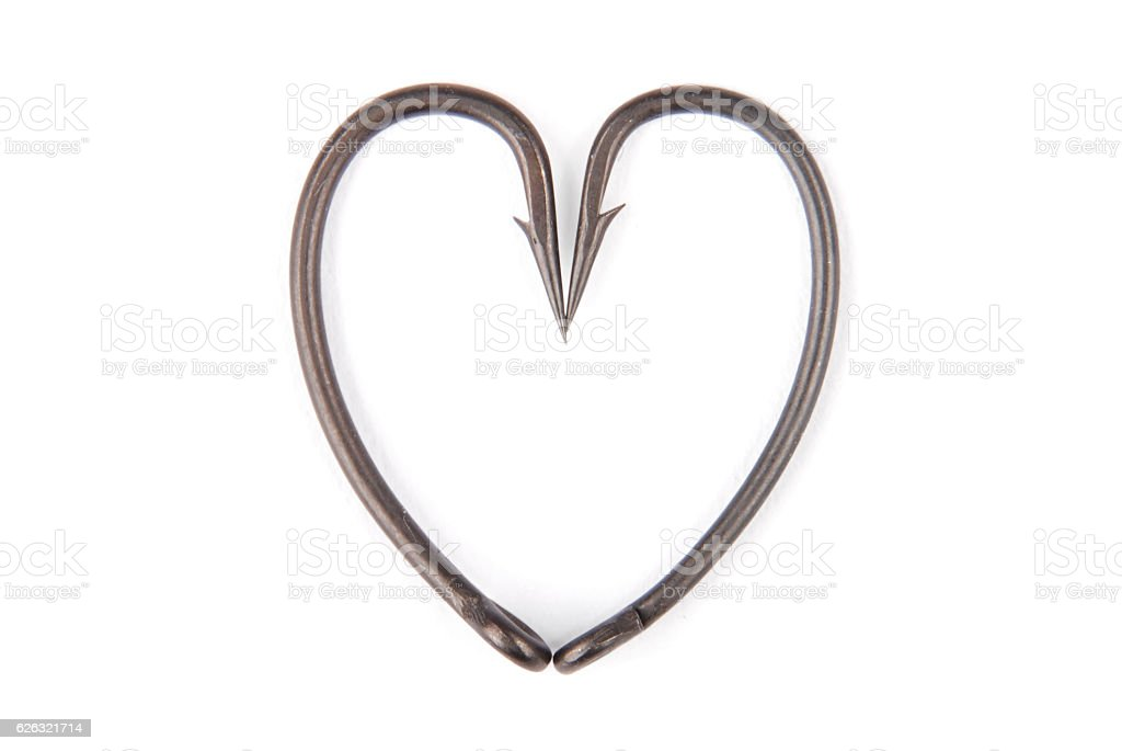 Four fishhook drawn up in heart shaped stock photo