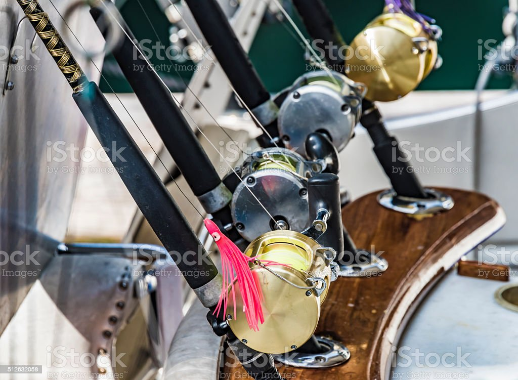 Four fishing rods and reels on a boat, horizonal image stock photo