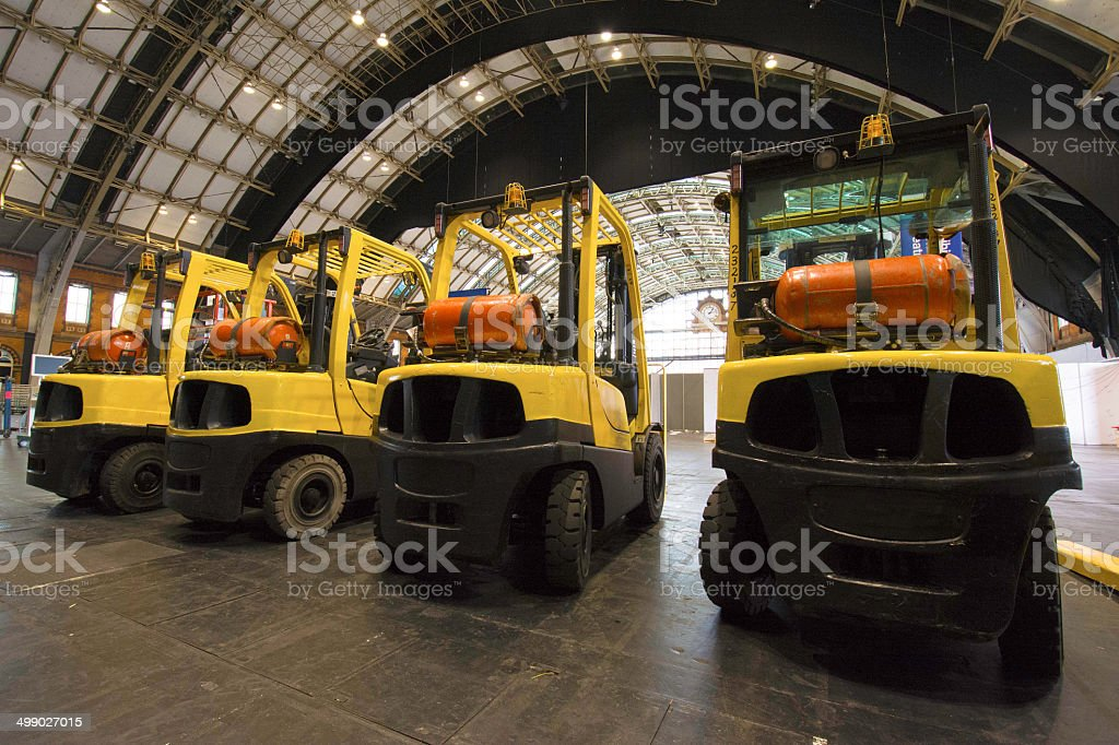 Four Forklift trucks waiting for the end of a show stock photo