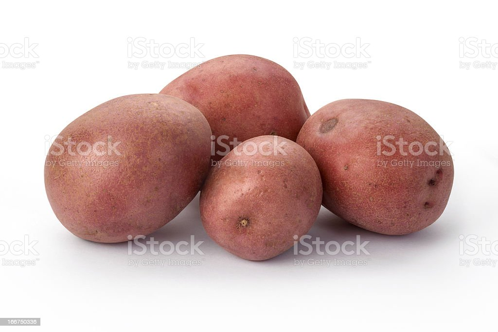 Four Fresh Red Potatoes in a Group isolated stock photo