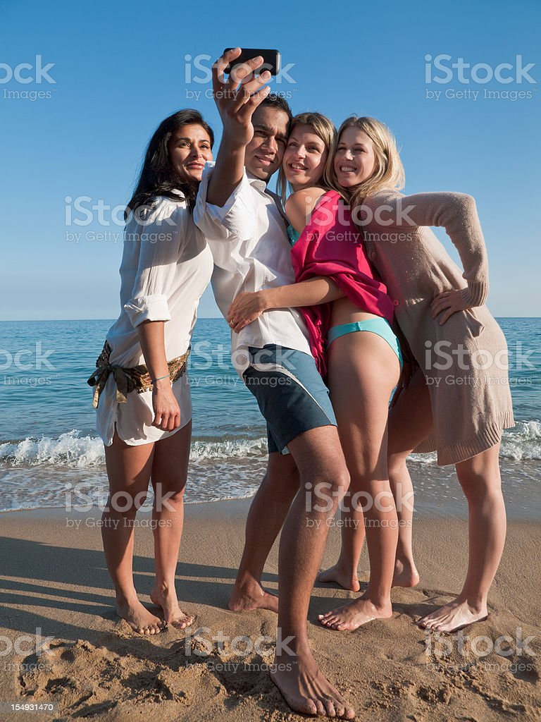 Four friend at the beach royalty-free stock photo
