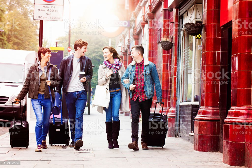 Four friends arriving in London stock photo