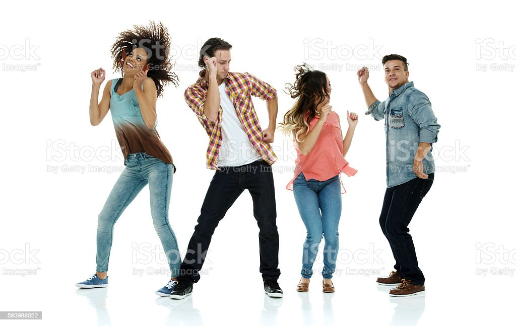 Four friends dancing together stock photo