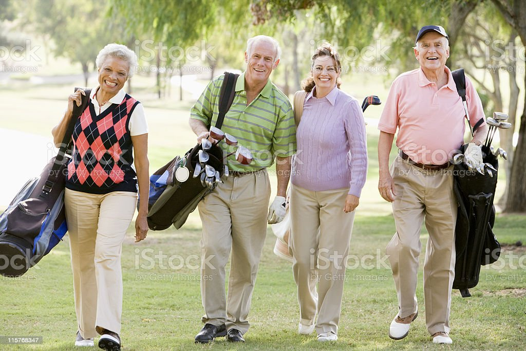 Four Friends Enjoying A Golf Game stock photo