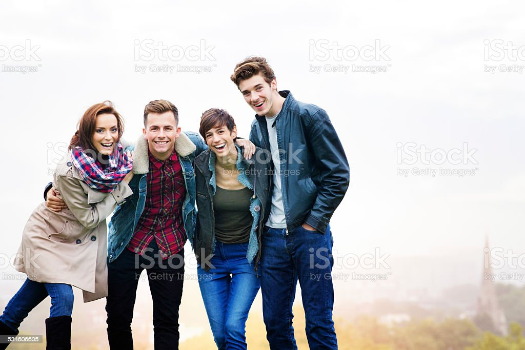 Four friends Fall group portrait on Primrose hill foggy day stock photo
