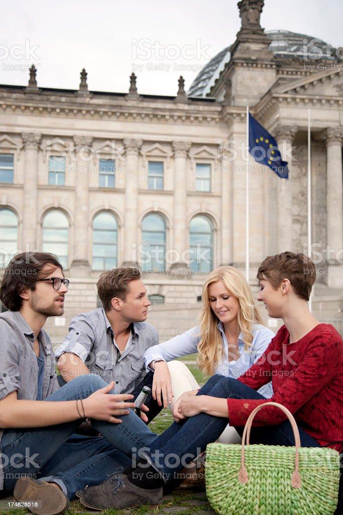 Four friends having fun in Berlin royalty-free stock photo