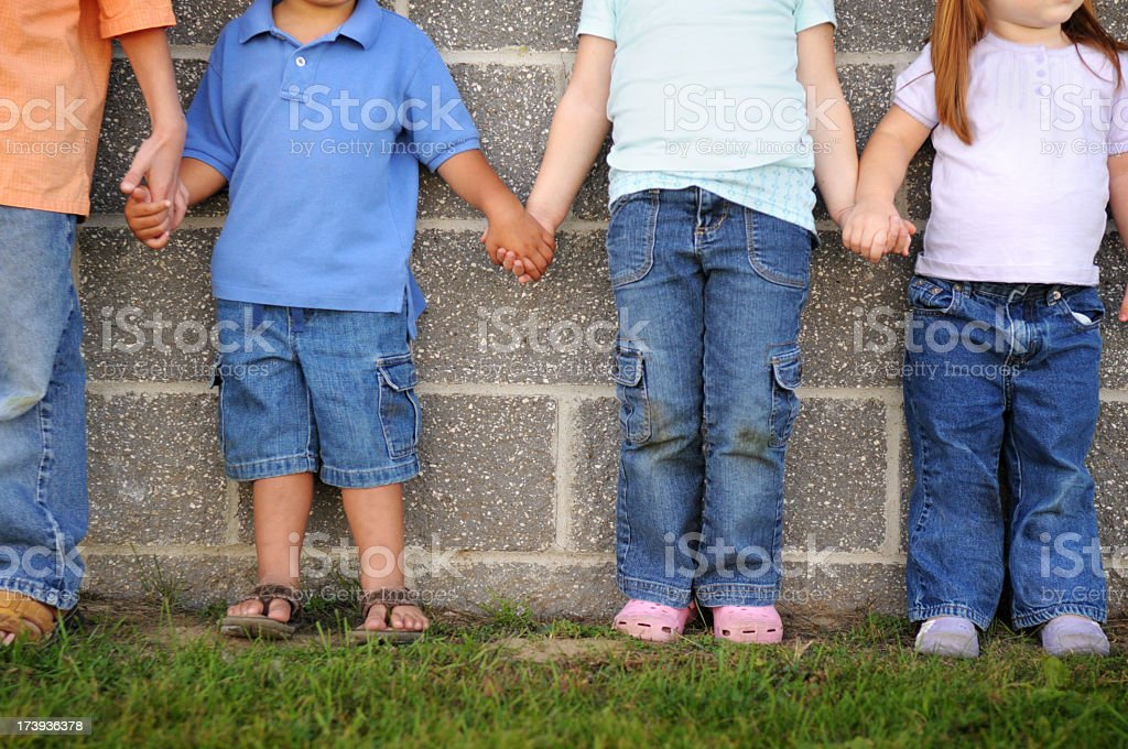 Four Friends Holding Hands royalty-free stock photo