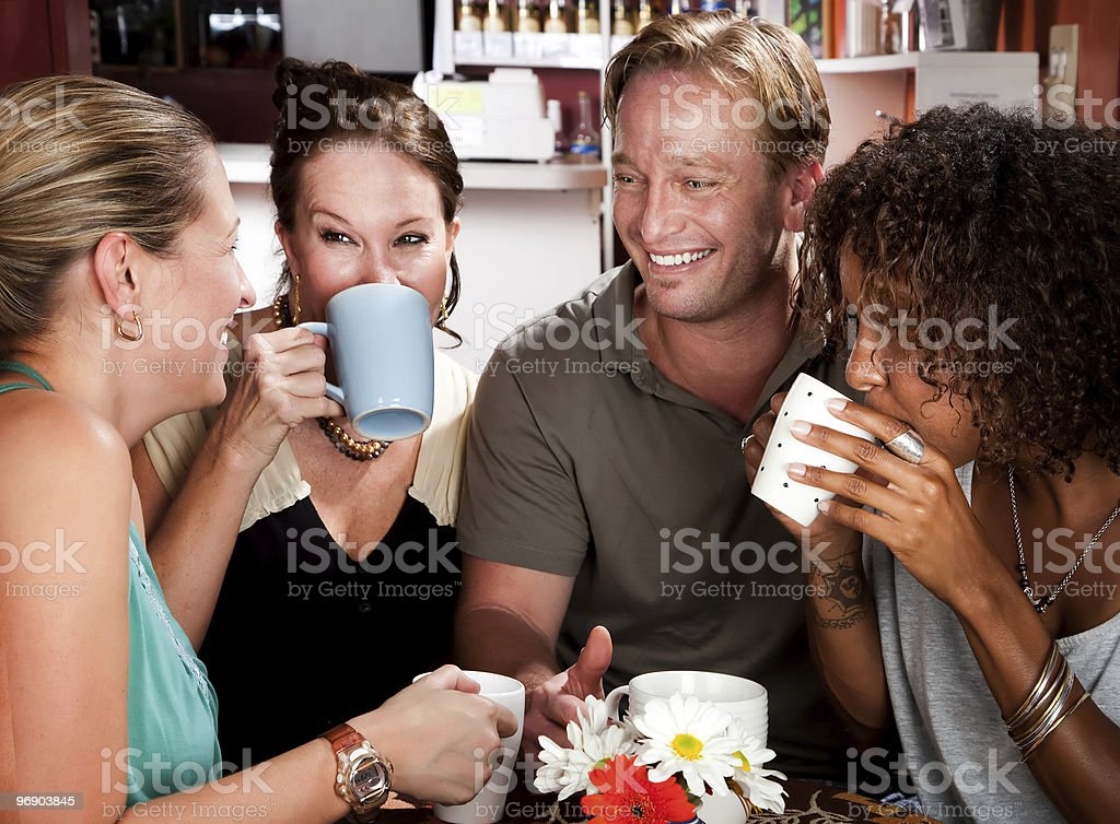 Four Friends in a Coffee House royalty-free stock photo